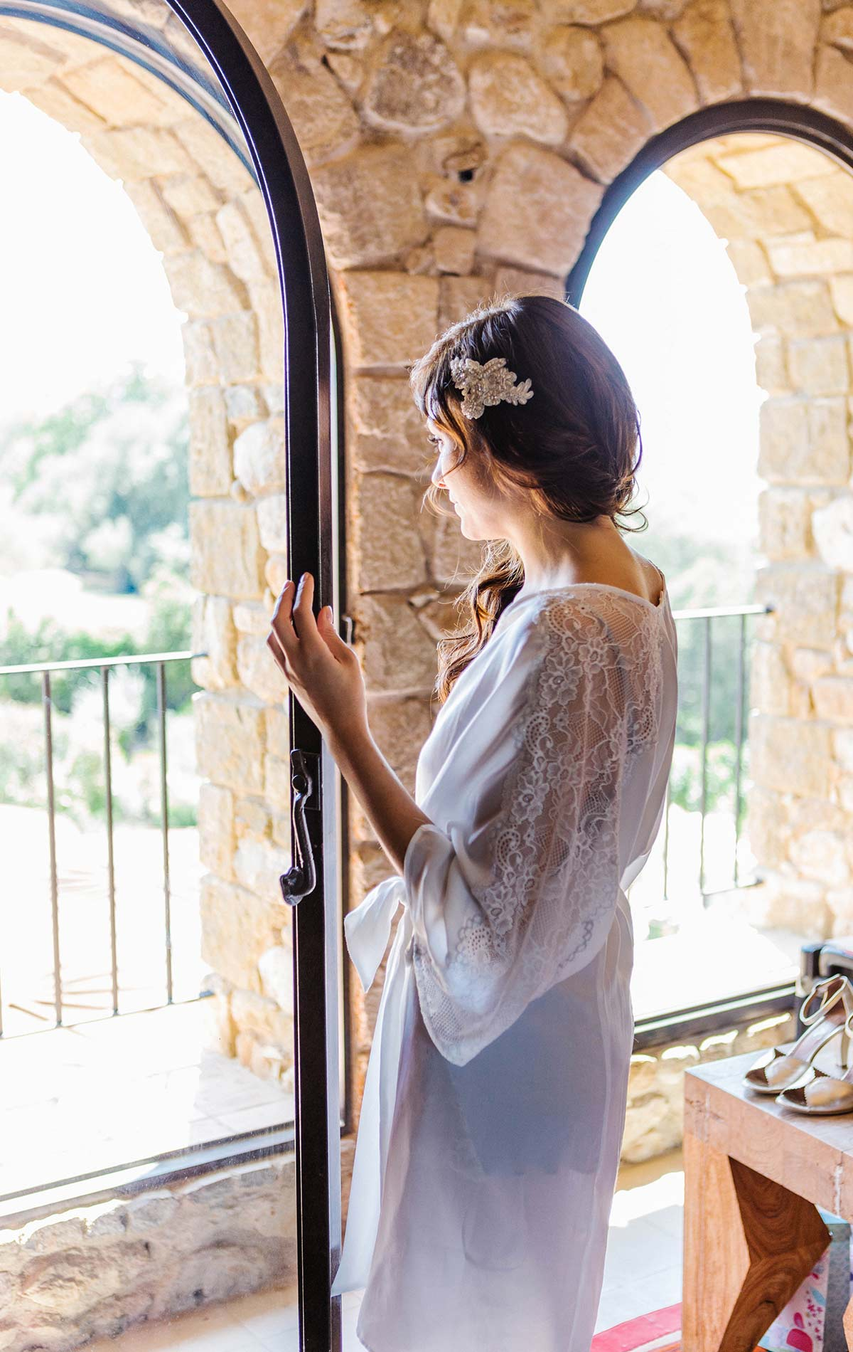 Bride looking in the window. Castell de Emporda wedding photogaphy. Castell de Emporda wedding photography. Destination wedding photographer Spain.