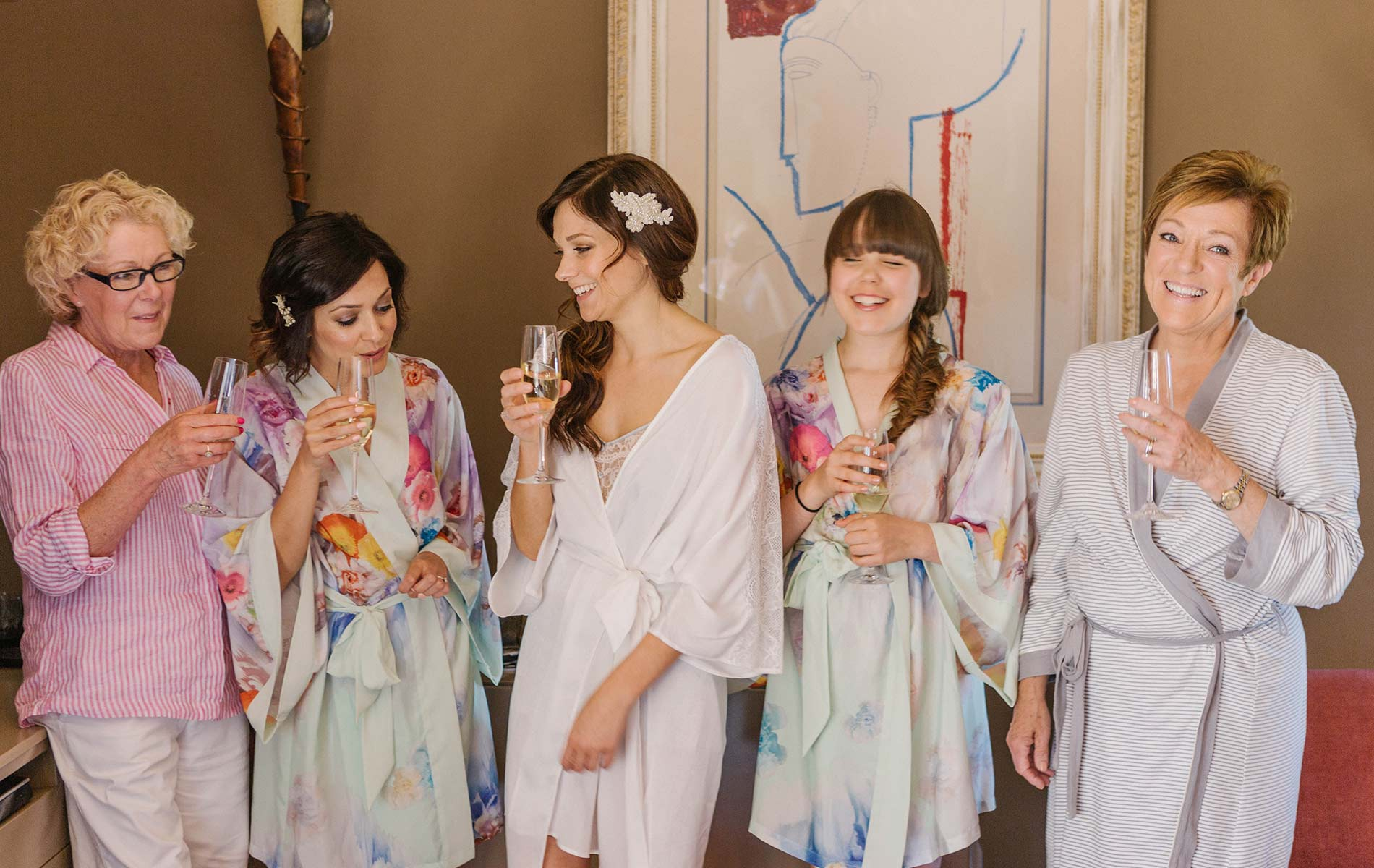 Bride and bridesmaids have fun. Wedding decarations. Castell de Emporda wedding photogaphy. Destination wedding photographer Spain.