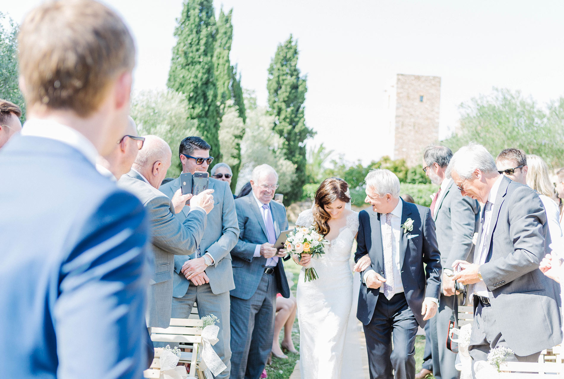 Bride and her dad. Wedding decarations. Castell de Emporda wedding photogaphy. Destination wedding photographer Spain.