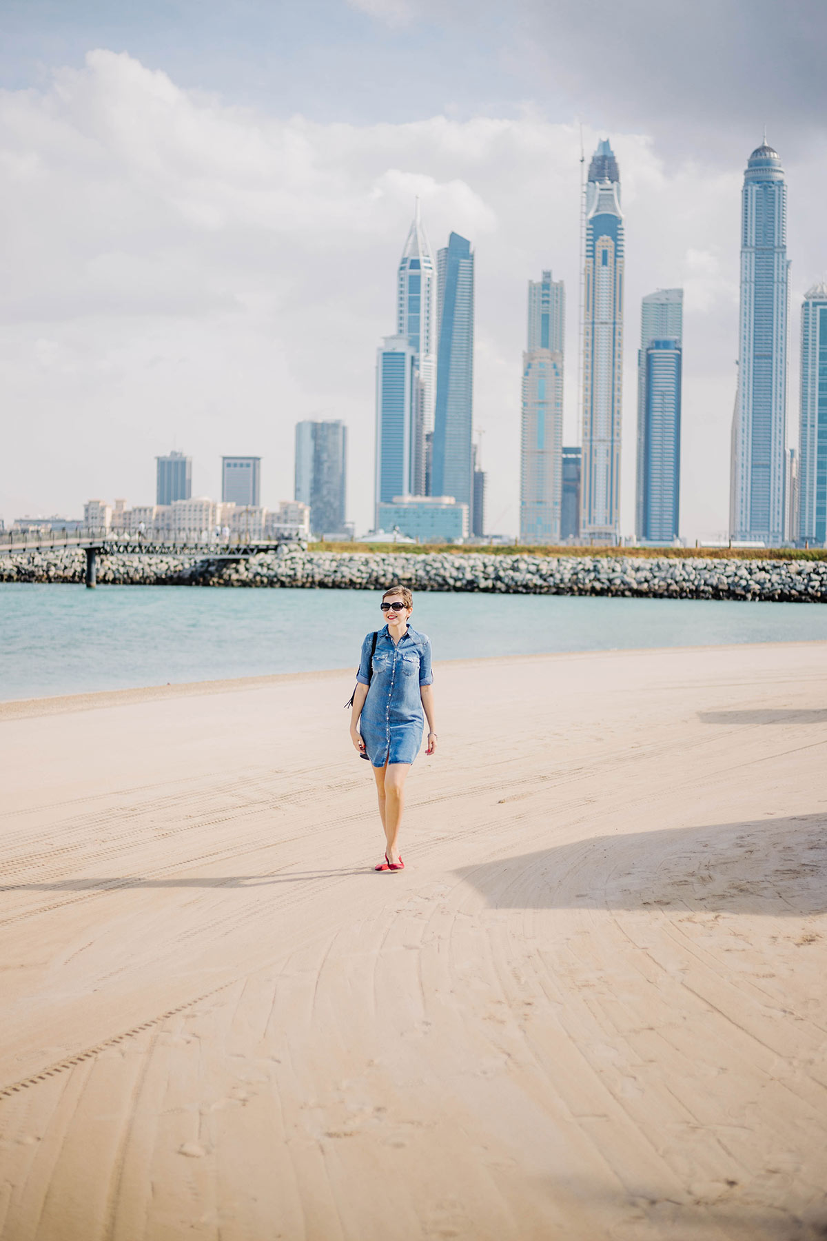 walking by the private beach at one and only hotel in Dubai